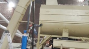 Moreson Incline ratler chain conveyer being fitted to Mixer